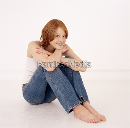 young woman sitting down resting head
