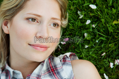 face of young woman lying on
