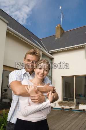 couple outside their house