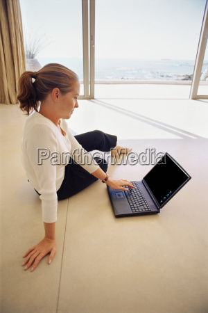 woman using laptop on living room