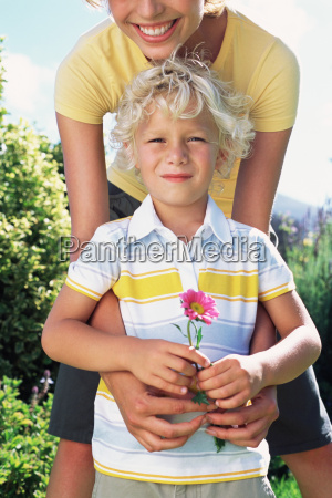 mother and son with flower