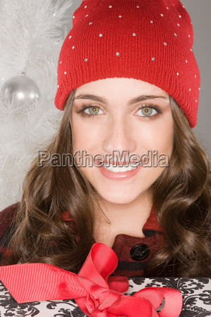smiling woman wearing a knit hat
