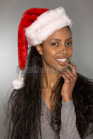 quizzical woman wearing a santa hat