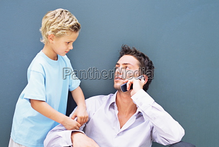 boy trying to get fathers attention