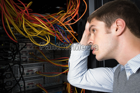confused looking computer technician