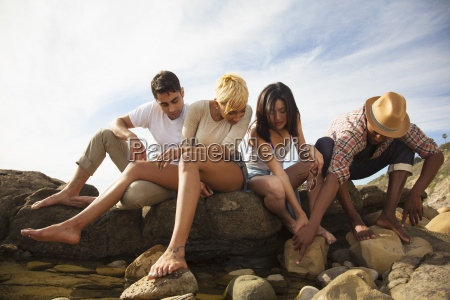 group of friends sitting together on