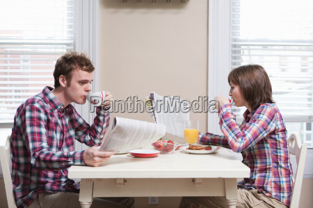 young couple having breakfast at kitchen