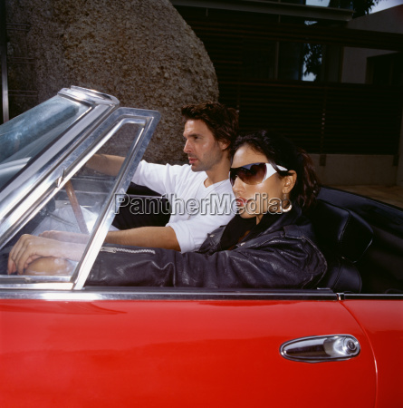 stylish couple in a convertible