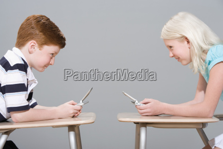 girl and boy using mobile phones