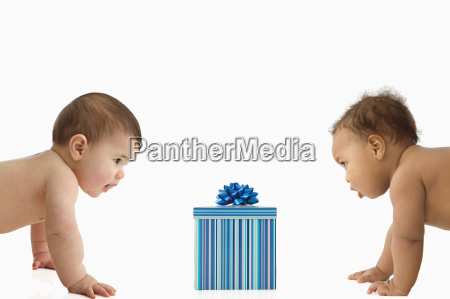 two babies with a gift box