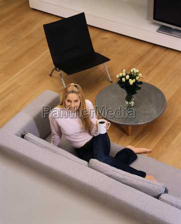 woman relaxing with a cup of