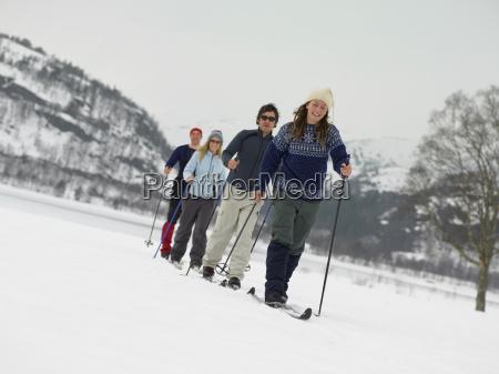 friends trekking through the snow