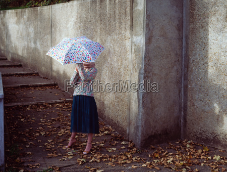 woman holding spotty umbrella