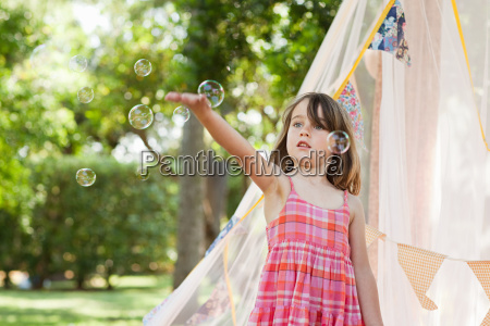 young girl with bubble wand