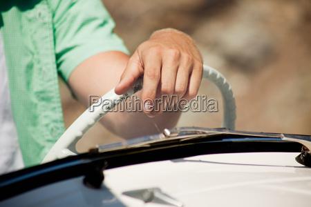 young man driving convertible car close