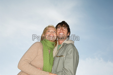 young couple looking up