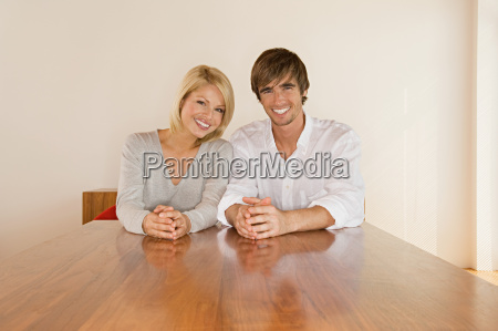 young couple sitting at table