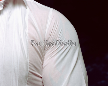 man wearing very tight shirt