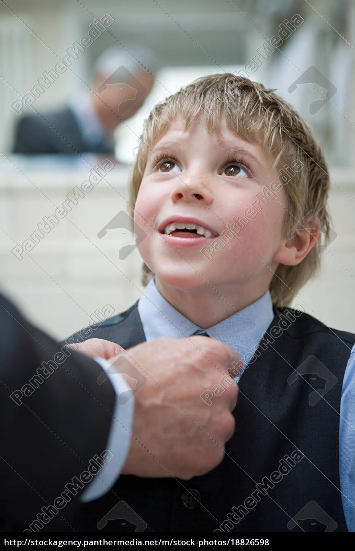 boy, having, his, tie, adjusted - 18826598