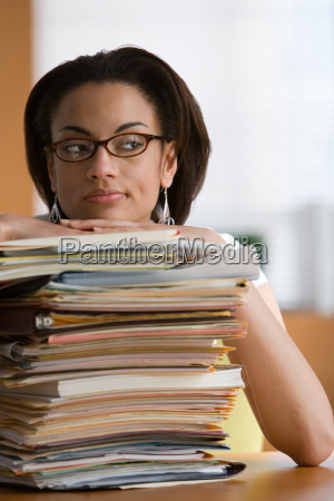 young woman leaning on stack of