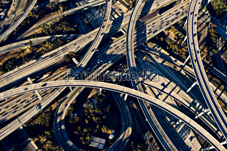 aerial view of sunlit curved flyovers