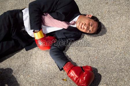 businessman unconscious on floor
