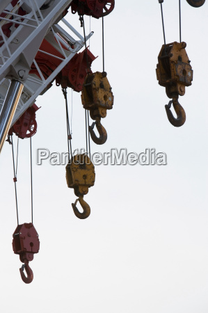 hooks hanging from crane