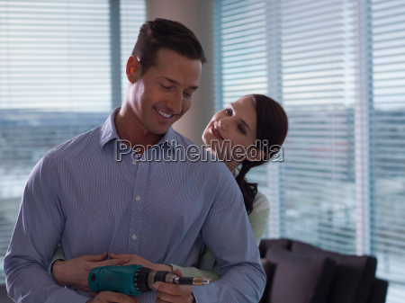 young woman embracing mid adult man