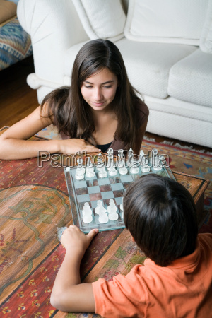 sister and brother with chessboard