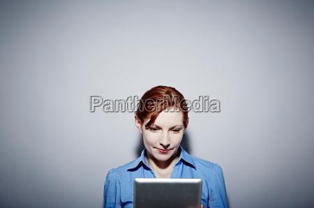 studio portrait of young woman looking
