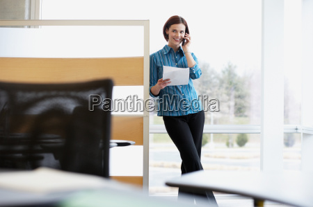 female office worker using a cellular