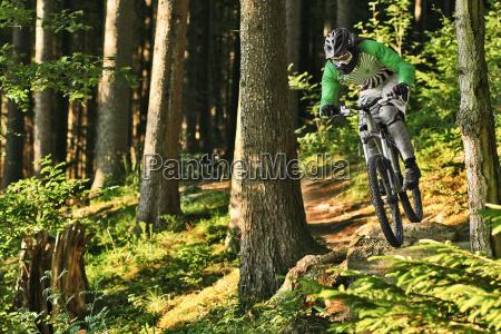 mountain biker riding off track through