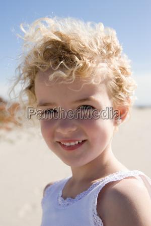 smiling girl posing on beach