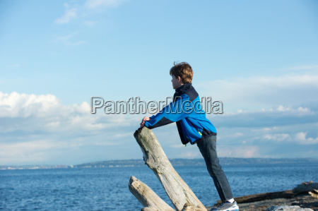 young boy looking out from bainbridge