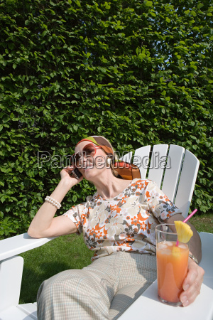 senior woman on cellphone in garden