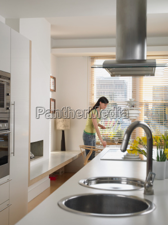 woman setting dining table