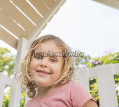 portrait of young girl smiling outdoors
