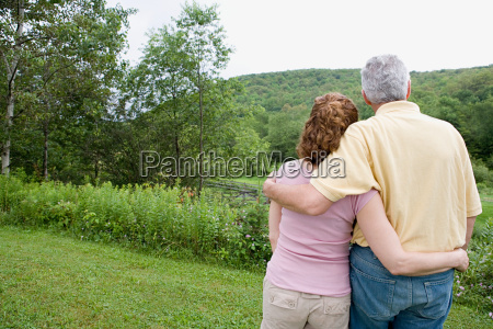 mature couple looking at view