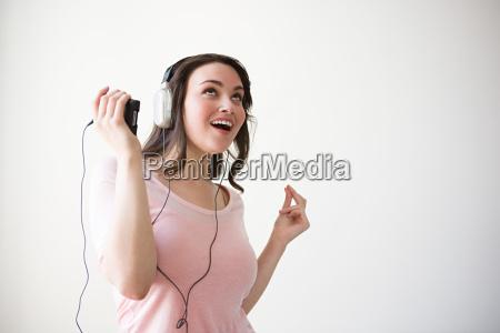 young woman enjoying music