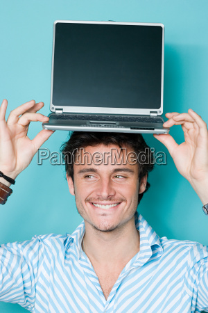 man with laptop on his head