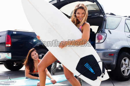 female friends with surf boards hermosa