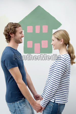 couple with house painted on the