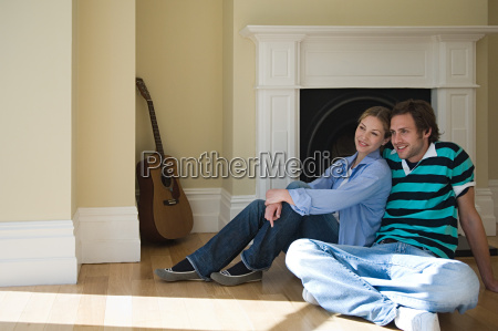 young couple sitting on floor
