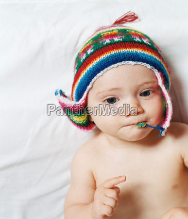 baby wearing a knitted hat