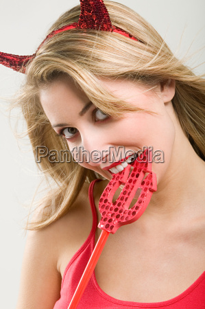 beautiful woman wearing a devil costume