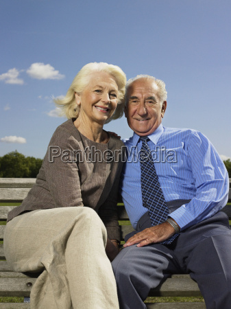 elderly couple relaxing in a park