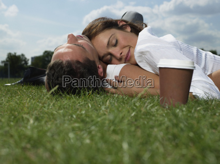 couple sleeping in the park