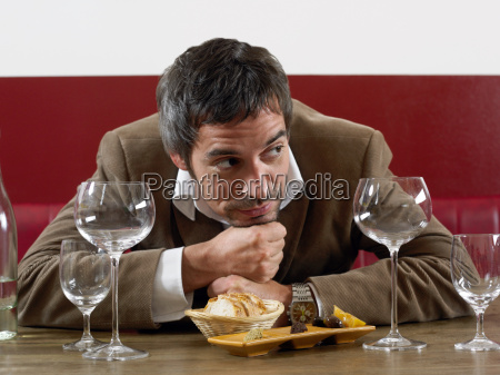 man at table with bread and