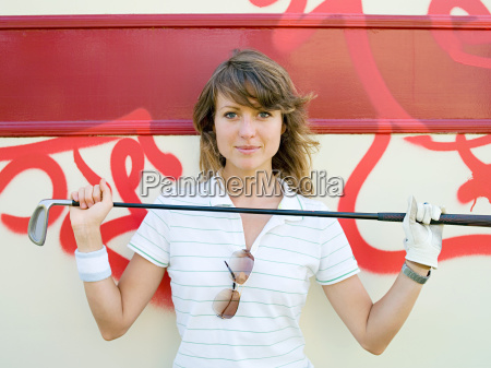 woman holding golf club