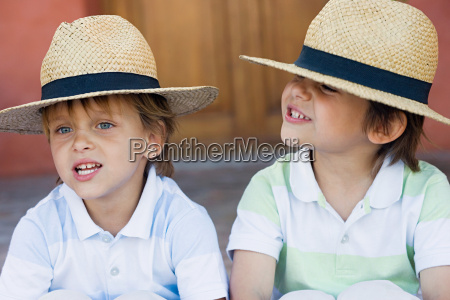 two boys wearing panama hats